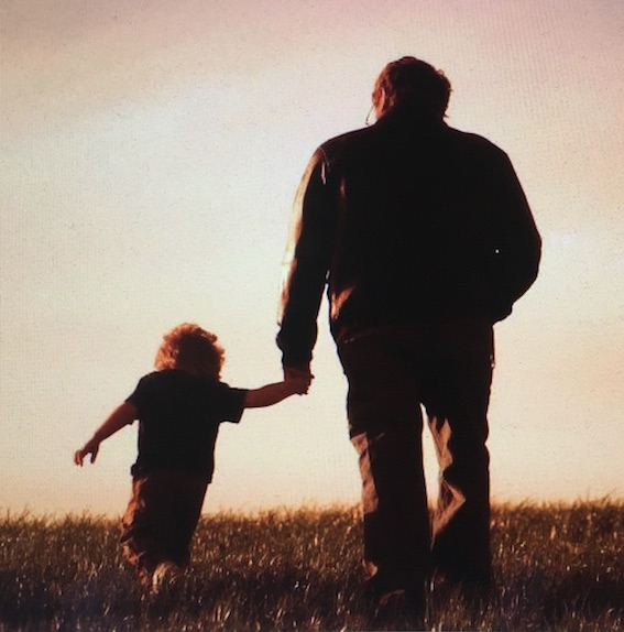 Father and child walking hand in hand