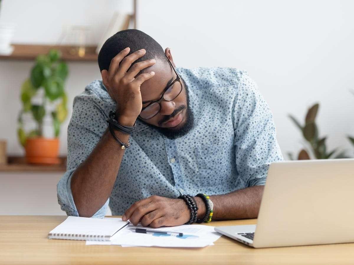 Man looking in despair at computer